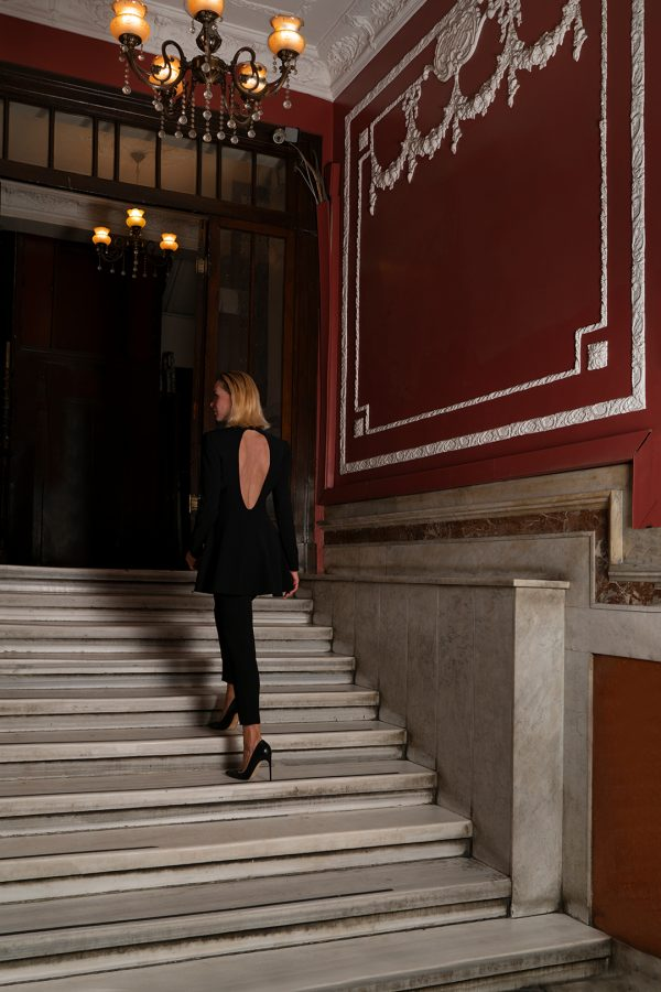 black suit, open back, elegant
